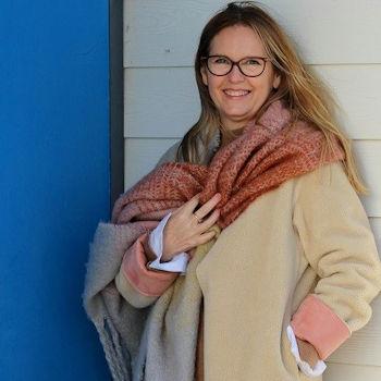Blogger Ashley from Lazy Daisy Jones wearing a scarf and camel coat