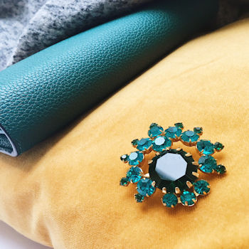 Green brooch pictures on yellow cushion