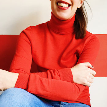 Me posing for a selfie wearing a red poloneck jumper and jeans