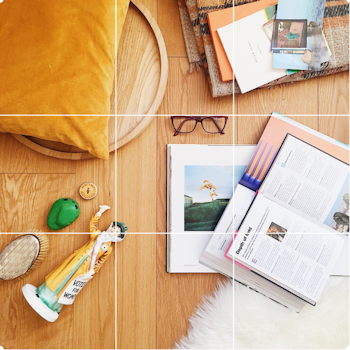 A flat lay by Helen Perry featuring a grid that demonstrates the Rule of Thirds in photographic composition